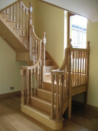 Oak Cut String Staircase With Double Scroll Handrails by Haughey Joinery, Co. Donegal